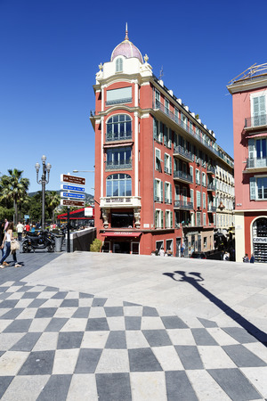 frontage: NICE, FRANCE - MAY 24, 2014: Architecture of frontage of Massena Square, seen in the distance, the largest square in the Old Town of Nice, its history goes back to the first half of the 19th century Editorial