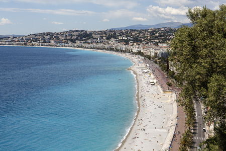 approx: NICE, FRANCE - MAY 15, 2014: Buildings of the city, sea shoreline and beaches, there are approx. 30 beaches spread over 7 km long coastline in the City Editorial