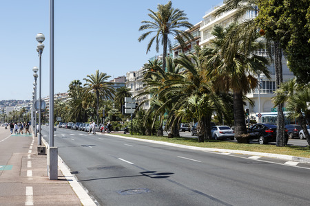 azure coast: NICE, FRANCE - MAY 18, 2014: The Walkway Of The English, the seven kilometers along the coast a favorite place of rest, walking and sport, a symbol of the Azure Coast