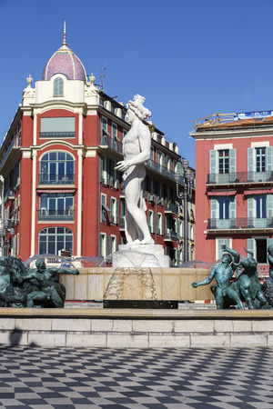 azure coast: NICE, FRANCE - MAY 18, 2014: Fountain Of The Sun unveiled in 1956 at Massena Square, the largest square in the Old Town of Nice Editorial