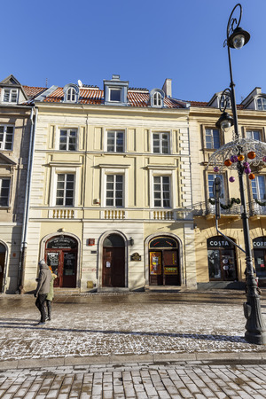 origins: WARSAW, POLAND - JANUARY 06, 2015: Made of brick townhouse, its origins date back to 18th century, burned by the Germans during the Warsaw Uprising in 1944, rebuild in 1950, renovated in 2007-2009