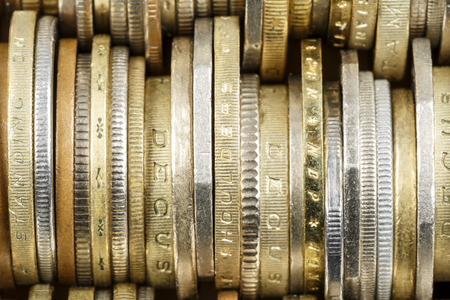 money savings: Various coins shown up close, forms the backdrop Stock Photo