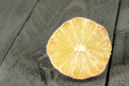 lamentable: The Dried lemon shown on wooden background Stock Photo