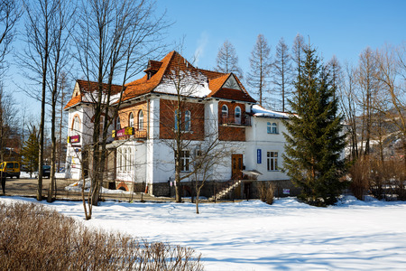 bank branch: ZAKOPANE, POLAND - MARCH 09, 2015: Villa Made of brick, built for Dr. Rozycki, design by E. Wesolowski in 1913, listed in the municipal register of architectural heritage, nowadays Alior Bank branch