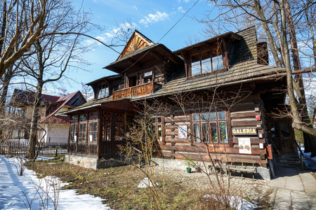owned: ZAKOPANE, POLAND - MARCH 10, 2015: Wooden residential building dates from 1897, was owned by a well-known doctor Waclaw-Kraszewski since 1912., Gallery of Modern Art since 1993