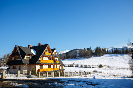 well equipped: ZAKOPANE, POLAND - MARCH 09, 2015: Villa named Wisienka located in an attractive place nearby the downtown in a large open space with beautiful views of the Tatras, offers 15 well equipped guest rooms