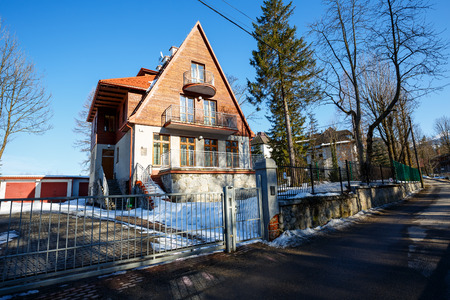 zakopane: ZAKOPANE, POLAND - MARCH 09, 2015: Villa named Strzelista built in 1929, with historic features listed in the register of architectural heritage Editorial