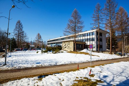 municipal editorial: ZAKOPANE, POLAND - MARCH 09, 2015: Office building probably dates from the mid-20th century, the seat of government and municipal office
