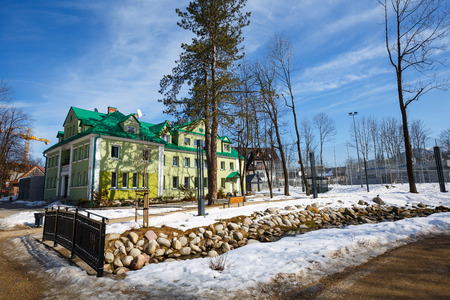 zakopane: ZAKOPANE, POLAND - MARCH 10, 2015: Brick building of the former Municipal Baths built in 1928, designed by E. Wesolowski, listed in the municipal register of architectural heritage