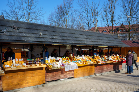 oscypek: ZAKOPANE, POLAND - MARCH 10, 2015: Regional food products at the largest marketplace in the city, among other offers there is oscypek Polish regional product protected by EU law Editorial