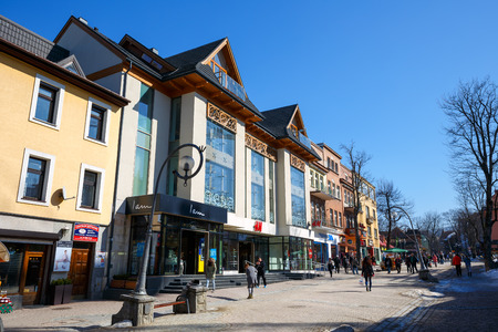 hm: ZAKOPANE, POLAND - MARCH 09, 2015: Commercial building with a total area of 2820 m2, it houses the fashion store of multinational company H&M since December 01, 2010, located at Krupowki Editorial