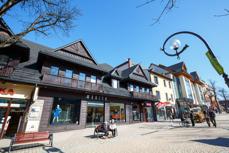 ZAKOPANE, POLAND - MARCH 09, 2015: Commercial premises located in wooden villa, built approx. 1910, at the main pedestrian street in the city named Krupowki