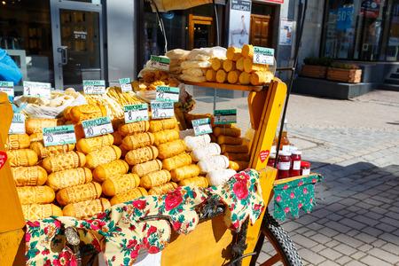 oscypek: ZAKOPANE, POLAND - MARCH 09, 2015: Sales of sheep cheeses named oscypek from the street stall at Krupowki, since February 02, 2007 oscypek is Polish regional product protected by EU law