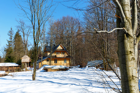approx: ZAKOPANE, POLAND - MARCH 09, 2015: Wooden villa in winter scenery in Zakopane built in approx. 1925, listed in the municipal register of architectural heritage