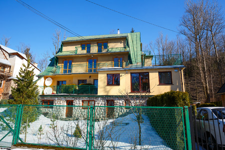 accommodations: ZAKOPANE POLAND  MARCH 09 2015: Residential house probably built in the mid20th century offers several accommodations for guests coming to town