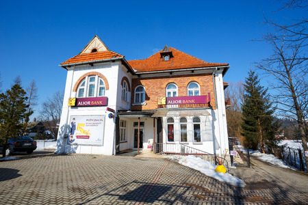 historic architecture: ZAKOPANE POLAND  MARCH 09 2015: Villa Made of brick built in 1913 for Dr. Rozycki design by E. Wesolowski  listed in the municipal records of historic architecture nowadays Alior Bank branch