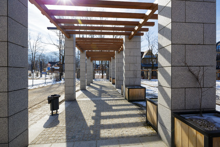 modernization: ZAKOPANE POLAND  MARCH 10 2015: New pergola made of stone at the Independence Square was created together with modernization of the square completed in 2013 years