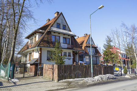 dwelling house: ZAKOPANE POLAND  MARCH 09 2015: Villa Starzykowka dwelling house also offers accommodations for guests coming to town in 6 guest rooms feature traditional Zakopane style