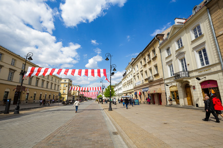 krakowskie przedmiescie: WARSAW POLAND  MAY 03 2015: Krakowskie Przedmiescie Str. a part of Trakt Krolewski in year 1994 declared a historical monument on the occasion of the flag day decorated with the national colors