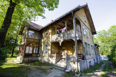 approx: ZAKOPANE, POLAND - JUNE 12, 2015: Wooden villa, guesthouse called Jerzewo built in approx. 1885, listed in the municipal register of architectural heritage