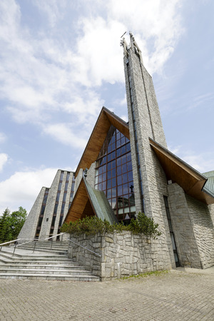 str: ZAKOPANE, POLAND - JUNE 11, 2015: Holy Cross Parish Church was built between 1983-1991 by the project of architect Professor Witold Ceckiewicz, located at Zamoyskiego str
