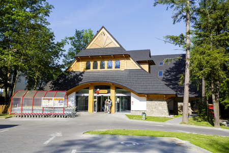 retail chain: ZAKOPANE, POLAND - JUNE 12, 2015: The facade of a store under the name Biedronka, retail chain with over 2600 stores in Poland, the building refers to the wooden architecture of Zakopane Style