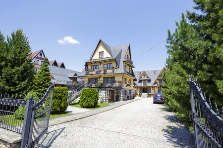 guesthouse: ZAKOPANE, POLAND - JUNE 13, 2015: Guesthouse named Danielka, built in architectural style characteristic of the region, offers 20 guest rooms for guests coming to town