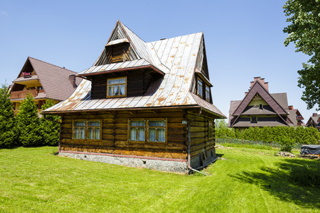 residential house: ZAKOPANE, POLAND - JUNE 13, 2015: Residential house, made of wood, built approx. 1955 Editorial