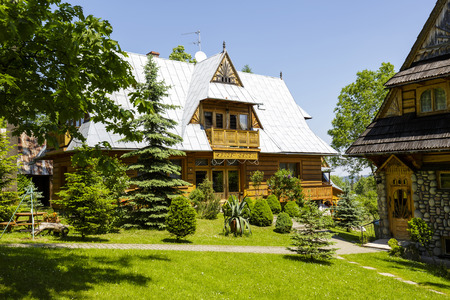 refers: ZAKOPANE, POLAND - JUNE 13, 2015: Cottage in the regional style, named Z Pode Drogi, architecturally refers to the style of the city