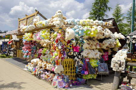 stuffed toys: ZAKOPANE, POLAND - JUNE 12, 2015: Various souvenirs offered for sale, the stand located along the famous pedestrian street, among other offers stylized stuffed toys