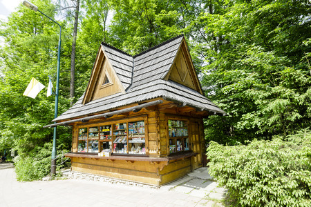 zakopane: ZAKOPANE, POLAND - JUNE 11, 2015: Newsstand offers the latest newspapers and magazines and and other small items. This newsstand built in the architecture style of the Zakopane
