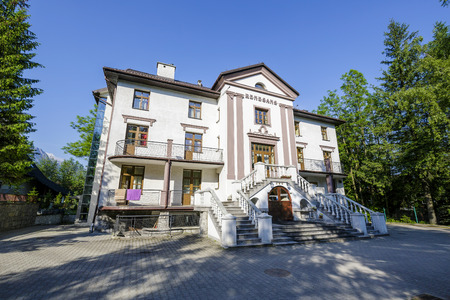 ZAKOPANE, POLAND - JUNE 12, 2015: Made of brick vacation house Renaissance Renesans, built in 1929, formerly known as FWP Postep, nowadays comfortable guest house with 21 guest rooms