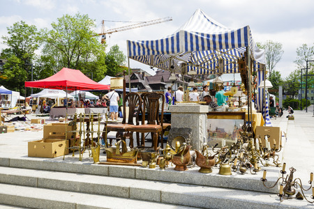 ongoing: ZAKOPANE, POLAND - JUNE 07, 2015: Antiques sale at the famous Independence Square, the only one square in the city, founded in the 19th century, recently opened after renovation ongoing since 2012
