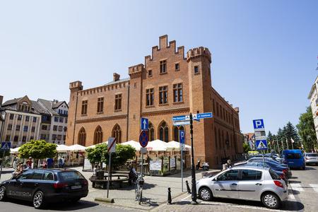 karl: KOLOBRZEG, POLAND - JULY 14, 2015: The neo-Gothic two-storey building of City Hall, built between 1829-1832, designed by Karl Friedrich Schinkel, rebuilt in 1913