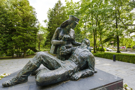 adolf: KOLOBRZEG, POLAND - JULY 16, 2015: Memorial to the women who fought during World War II for the Homelands liberty in the ranks of Polish Army, designed by Adolf Cogiel, unveiled on July 1980 Editorial