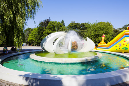 pioneers: KOLOBRZEG, POLAND - JULY 14, 2015: The Fountain known as the Flower, restored in 2013, located on Pioneers Square