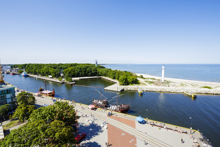 sea seaport: KOLOBRZEG, POLAND - JULY 17, 2015: The port canal leading to the seaport on the Baltic Sea. Port offers 18 quayside and its total area is 240 hectares