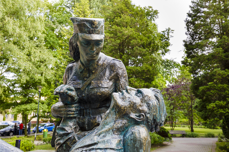 adolf: KOLOBRZEG, POLAND - JULY 16, 2015: Memorial detail to the women who fought during World War II for the Homelands liberty in the ranks of Polish Army, designed by Adolf Cogiel, unveiled on July 1980 Editorial