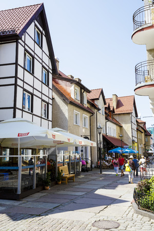 KOLOBRZEG, POLAND - JULY 14, 2015: Tenement houses at Mariacka Str. in the Old Town district are practically new part of the town rebuilt after the devastation of World War II