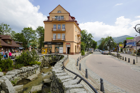 tenement: ZAKOPANE, POLAND - JUNE 26, 2015: The Tenement built in the early 20th century by Franciszek Smeja furrier, at the place of the old wooden workshop in downtown