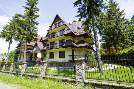 reminding: ZAKOPANE, POLAND - JUNE 15, 2015: A complex of modern buildings reminding the style of the long history of architecture of the region , located at Bulwary Slowckiego, built early the 21st century