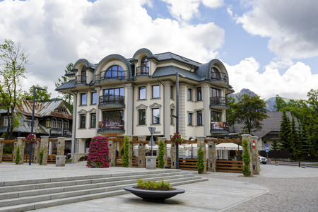 Polonia: ZAKOPANE, POLAND - JUNE 21, 2015: A modern apartment block built on the site of a former printing house - Polonia, on the ground floor of the building operates fine-dining restaurant since July 2014