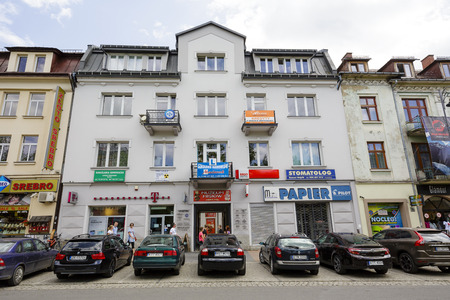 tenement: ZAKOPANE, POLAND - JUNE 14, 2015: Brick townhouse, built approx. 1930, located at the street of Kosciuszko, listed in the municipal register of architectural heritage Editorial