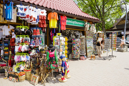 european culture: ZAKOPANE, POLAND - JUNE 07, 2015: Various souvenirs offered for sale, the stands located along the famous pedestrian street, among other offers stylized gifts and many small stuff