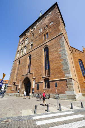 frontage: KOLOBRZEG, POLAND - JULY 14, 2015: Frontage of the Basilica of the Assumption of the Blessed Virgin Mary, the Roman-Catholic temple built in the fourteenth century Gothic style