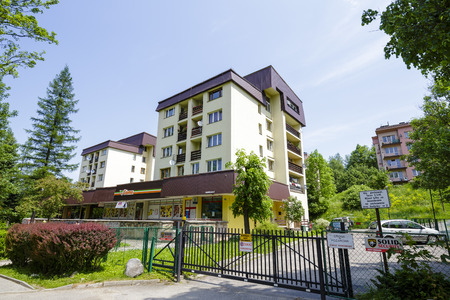 str: ZAKOPANE, POLAND - JUNE 09, 2015: Housing estate at Jagiellonska Str , complex of residential buildings, architectural style for the city and the region were often built in the twentieth century