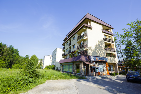 housing style: ZAKOPANE, POLAND - JUNE 12, 2015: Housing estate at the street of Piasecki, complex of residential buildings, architectural style for the city and the region were often built in the twentieth century