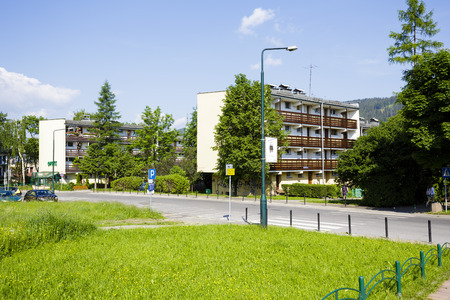 str: ZAKOPANE, POLAND - JUNE 12, 2015: Housing estate at Zborowski Str., residential buildings complex , architectural style for the city and the region were often built in the twentieth century Editorial