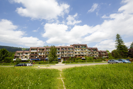 housing style: ZAKOPANE, POLAND - JUNE 11, 2015: Housing estate along the street Stolarczyk, residential buildings complex , architectural style for the city and the region were often built in the twentieth century