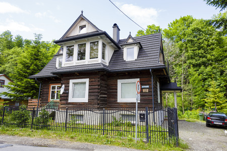 residential house: ZAKOPANE, POLAND - JUNE 21, 2015: Made of wooden logs the residential house, built approx. 1930, listed in the municipal records of historic architecture Editorial